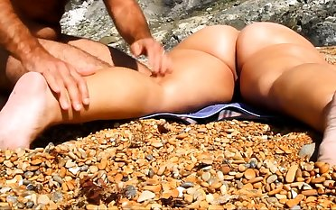 Massage girl pussy and ass at beach