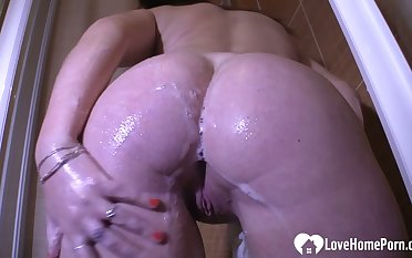 Cute brunette masturbates passionately beside the shower
