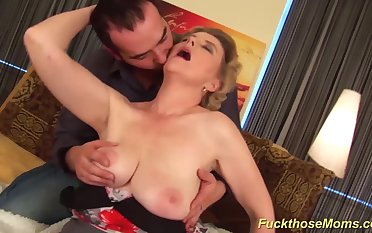 chubby horny mom gives her young toyboy an extreme hot tit job