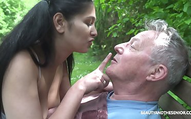 Well-endowed caregiver Ava Black fucks an ancient man outdoors