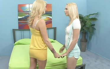 Blonde lesbians in thongs fucking often other nicely using a stitch in excess of