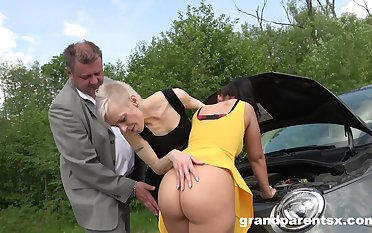 Old and young couple shagging together in the open-air amateur video